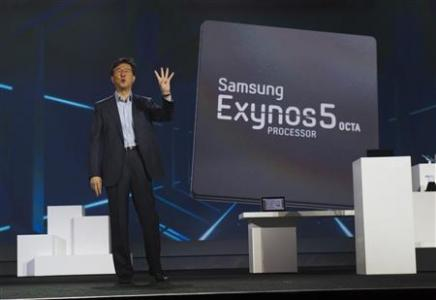 Stephen Woo, president of Device Solutions Business for Samsung Electronics, talks about the new Samsung Exynos 5 Octa processor during a keynote address at the CES in Las Vegas